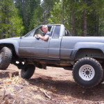 85 Toyota 4x4 with 33 inch tires and rear lift shackles