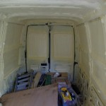 2002 Stealth Camper Van after spray foam applied to interior walls